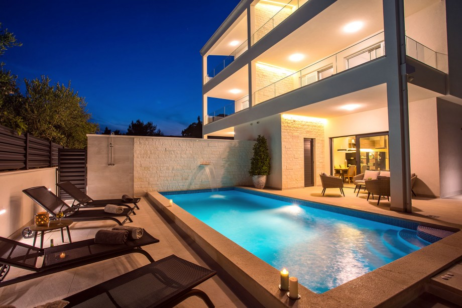 Seafront Villa Petra in the evening with beautiful lights & heated Pool