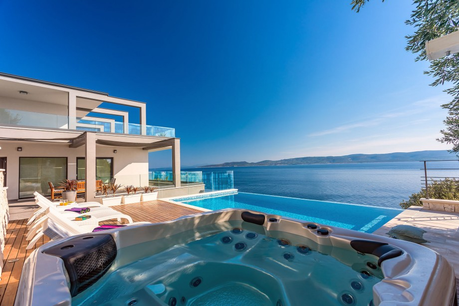 VILLA HRID with infinity heated pool with massage and private beach
