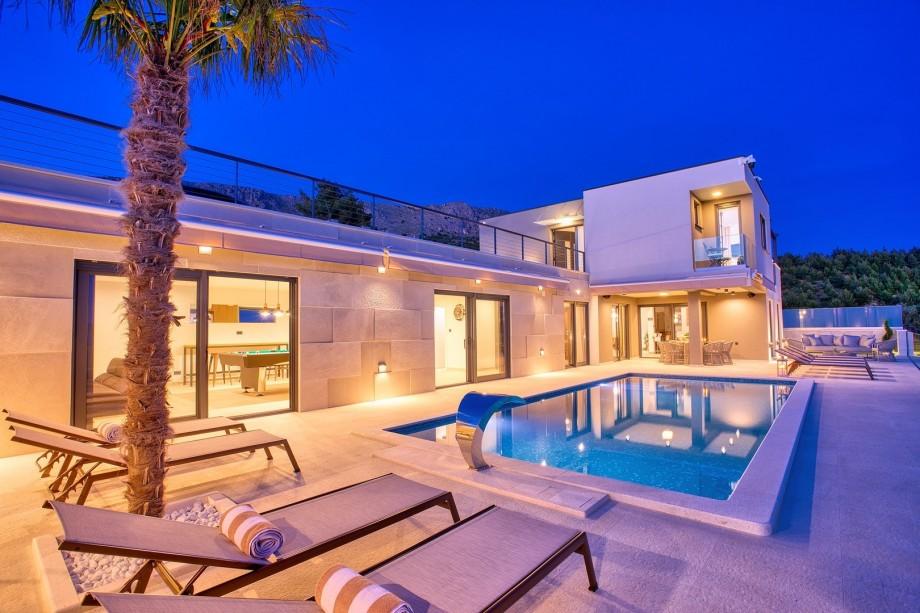 Luxury 4-bedroom villa with heated pool, pool table, sauna, a hot tub, and stunning sea views